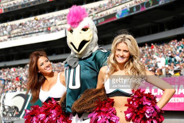 Philadelphia Eagles mascot visits with cheerleaders on the sideline during the game against the Detroit Lions at Lincoln Financial Field on October...