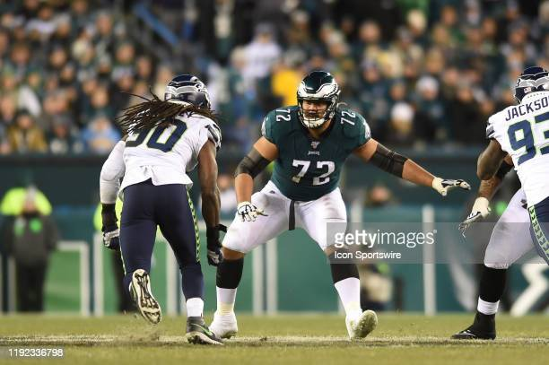 Philadelphia Eagles offensive tackle Halapoulivaati Vaitai blocks Seattle Seahawks defensive end Jadeveon Clowney during the Playoff game between the...