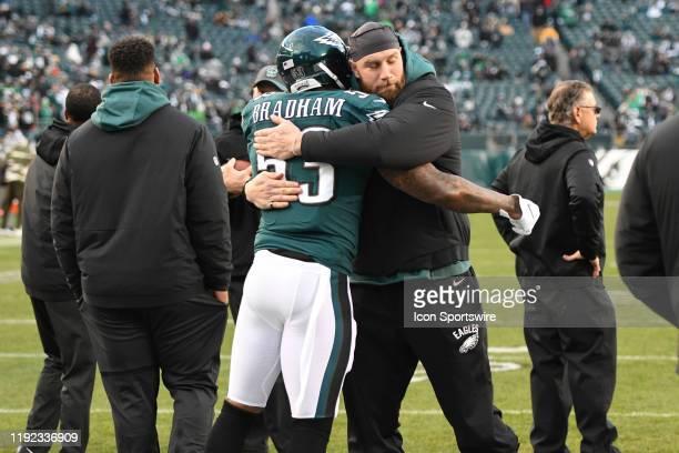 Philadelphia Eagles offensive tackle Lane Johnson hugs Philadelphia Eagles outside linebacker Nigel Bradham during the Playoff game between the...