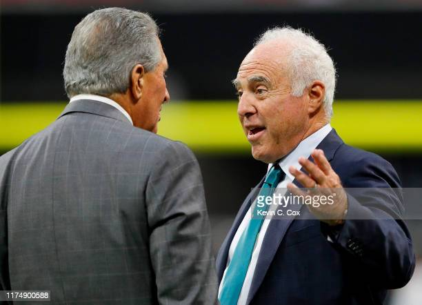 Philadelphia Eagles owner Jeffrey Lurie and Atlanta Falcons owner Arthur Blank talk before the game at Mercedes-Benz Stadium on September 15, 2019 in...