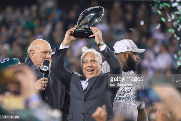 Philadelphia Eagles owner Jeffrey Lurie celebrates by holding up the NFC Championship trophy with Fox Sports analyst Terry Bradshaw after the NFC...