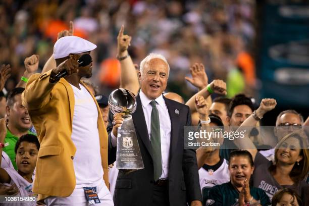 Philadelphia Eagles owner Jeffrey Lurie hoists the Vince Lombardi Trophy with hall of famer Brian Dawkins before the game against the Atlanta Falcons...