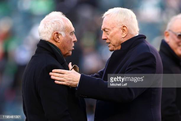 Philadelphia Eagles owner Jeffrey Lurie talks with Dallas Cowboys owner Jerry Jones before the game at Lincoln Financial Field on December 22, 2019...