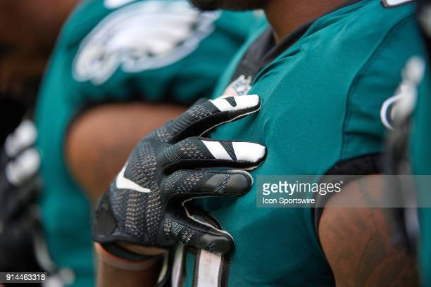 Philadelphia Eagles player is seen holding his hand over his heart during the playing of the National Anthem prior to the start of the NFL football...