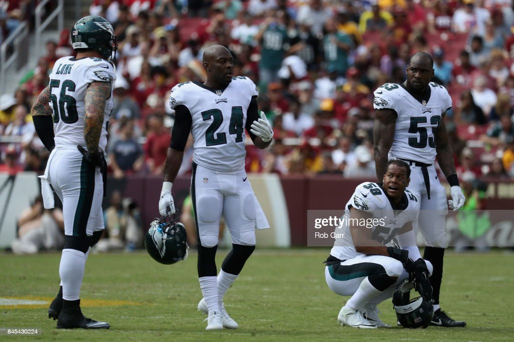 Philadelphia Eagles players Chris Long #56, Corey Graham #24, Jordan Hicks #58, and Nigel Bradham #53 of the Philadelphia Eagles talk against the Washington Redskins at FedExField on September 10, 2017 in Landover, Maryland.