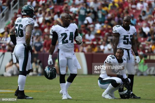 Philadelphia Eagles players Chris Long Corey Graham Jordan Hicks and Nigel Bradham of the Philadelphia Eagles talk against the Washington Redskins at...