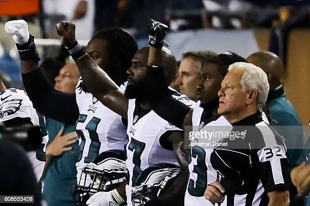 Philadelphia Eagles players hold up a salute during the national anthem prior to the game against the Chicago Bears at Soldier Field on September 19...