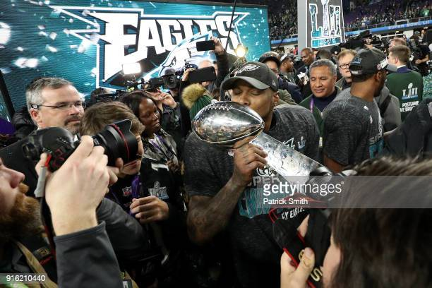 Philadelphia Eagles players kiss the Lombardi Trophy after defeating the New England Patriots in Super Bowl LII at US Bank Stadium on February 4 2018...