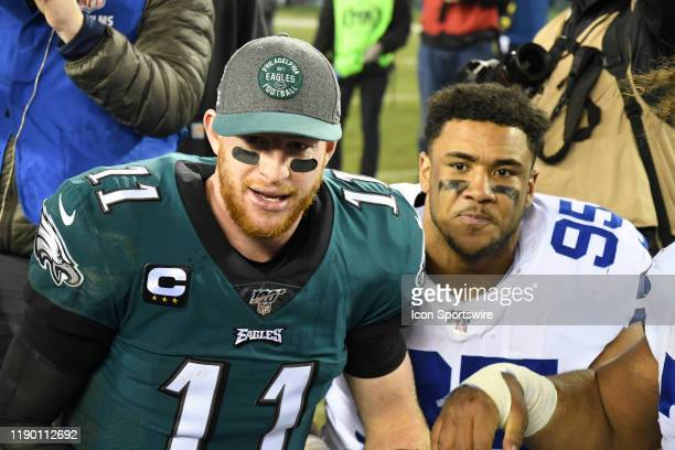 Philadelphia Eagles Quarterback Carson Wentz and Dallas Cowboys Defensive Tackle Christian Covington take a minute to pray during the game between...