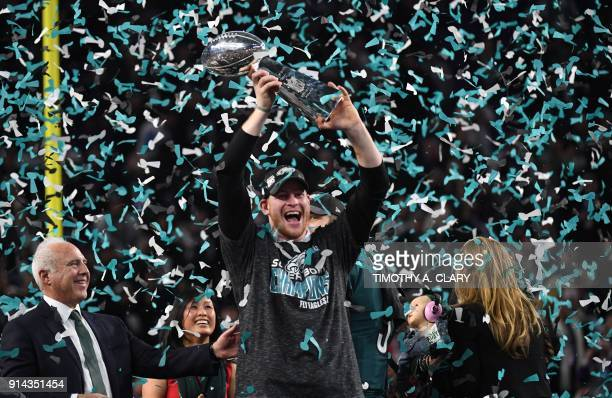 TOPSHOT Philadelphia Eagles quarterback Carson Wentz celebrates after winning Super Bowl LII against the New England Patriots at US Bank Stadium in...
