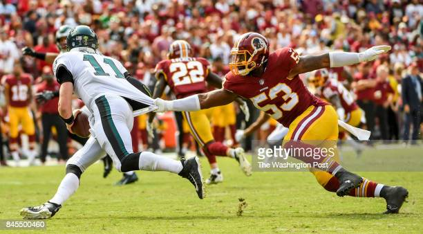 Philadelphia Eagles quarterback Carson Wentz gets away from Washington Redskins linebacker Zach Brown to complete a third and 10 conversion pass...