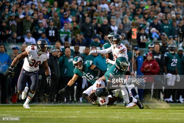 Philadelphia Eagles quarterback Carson Wentz gets taken down by Chicago Bears outside linebacker Pernell McPhee but gains the first down during the...