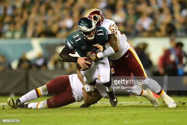 Philadelphia Eagles quarterback Carson Wentz is sacked by Washington Redskins inside linebacker Zach Brown during a NFL football game between the...