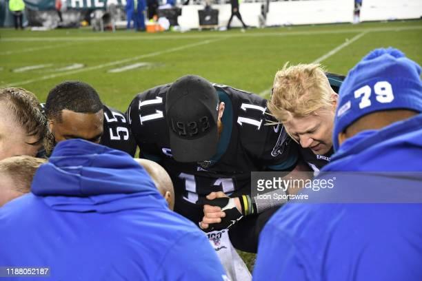 Philadelphia Eagles quarterback Carson Wentz prays during the game between the New York Giants and the Philadelphia Eagles on December 9 2019 at...