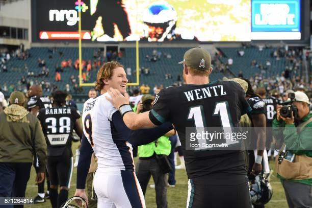 Philadelphia Eagles quarterback Carson Wentz shakes hands with Denver Broncos punter Riley Dixon during a NFL football game between the Denver...