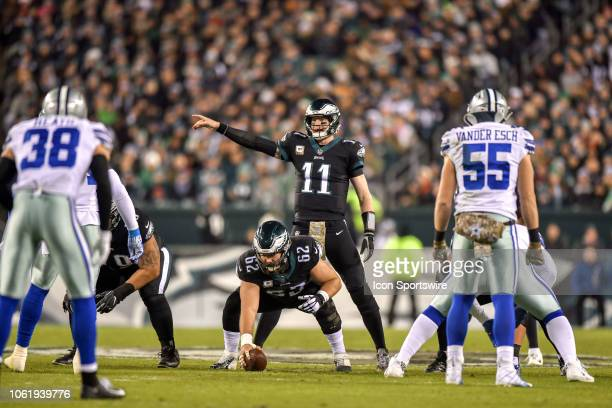 Philadelphia Eagles quarterback Carson Wentz signals to his team from the line of scrimmage during the NFL game between the Dallas Cowboys and the...