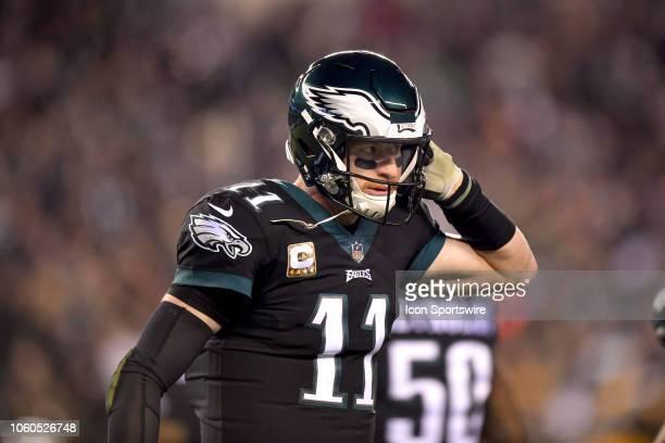 Philadelphia Eagles quarterback Carson Wentz unbuckles his helmet during the NFL game between the Dallas Cowboys and the Philadelphia Eagles on...