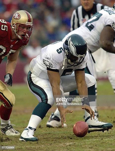 Philadelphia Eagles quarterback Donovan McNabb fumbles the ball before San Francisco 49ers defensive end John Engelberger during the second quarter...
