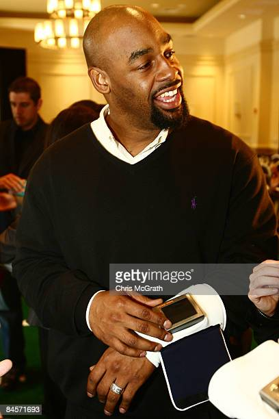 Philadelphia Eagles quarterback Donovan McNabb plays with the ID Coach Wristband at the launch of the Isaac Daniel, ID Coach at the Sheraton...