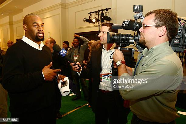 Philadelphia Eagles quarterback Donovan McNabb talks to the media after testing the ID Coach Wristband at the launch of the Isaac Daniel, ID Coach at...