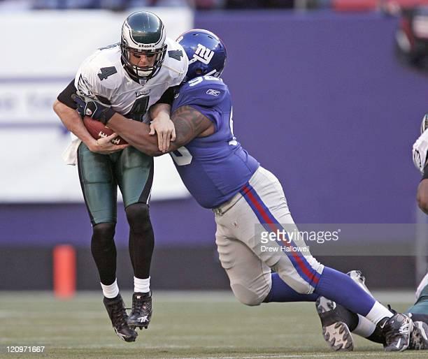 Philadelphia Eagles quarterback Mike McMahon gets sacked by New York Giants defensive end Michael Strahan , Sunday, November 20, 2005 at Giants...