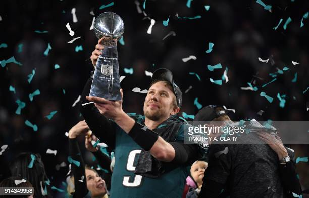 TOPSHOT Philadelphia Eagles quarterback Nick Foles celebrates after winning Super Bowl LII against the New England Patriots at US Bank Stadium in...