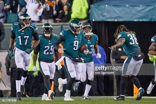 Philadelphia Eagles quarterback Nick Foles celebrates with teammates after throwing a touchdown pass to Philadelphia Eagles wide receiver Alshon...