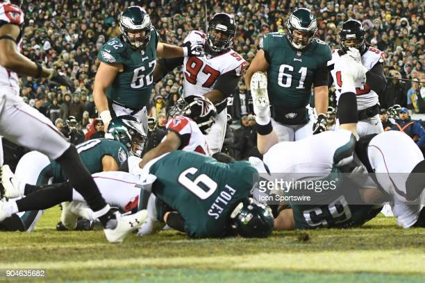 Philadelphia Eagles quarterback Nick Foles jumps on a fumble on the one yard line during the NFC Divisional Playoff game between the Philadelphia...