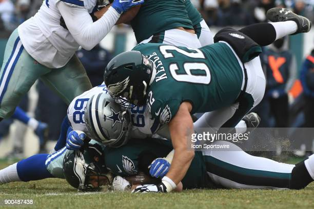 Philadelphia Eagles quarterback Nick Foles recovers his own fumble under Dallas Cowboys tight end Blake Jarwin during the NFL game between the...