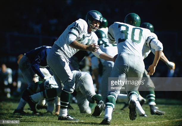 Philadelphia Eagles' quarterback, Norm Van Brocklin , playing the Giants.