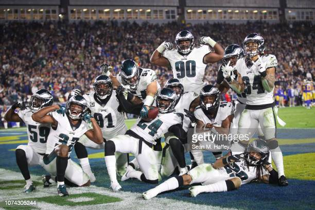 Philadelphia Eagles react after a fumble recovery in the third quarter against the Los Angeles Rams at Los Angeles Memorial Coliseum on December 16...