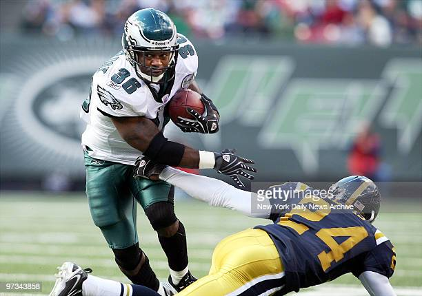 Philadelphia Eagles' running back Brian Westbrook breaks the tackle of New York Jets' cornerback Darrelle Revis in the first half of a game at Giants...