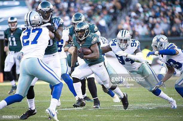 Philadelphia Eagles Running Back Byron Marshall outruns Dallas Cowboys Defensive End Randy Gregory in the second half during the game between the...