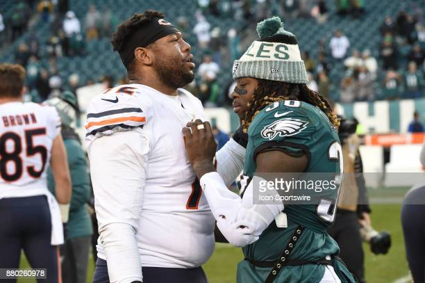 Philadelphia Eagles running back Jay Ajayi and Chicago Bears offensive tackle Charles Leno have a conversation during a NFL football game between the...