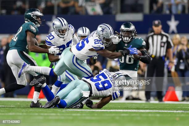 Philadelphia Eagles running back Jay Ajayi is hit by Dallas Cowboys safety Xavier Woods and linebacker Anthony Hitchens during the game between the...