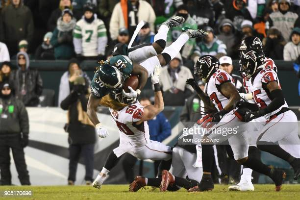 Philadelphia Eagles running back Jay Ajayi is upended by Atlanta Falcons defensive end Brooks Reed during the NFC Divisional Playoff game between the...