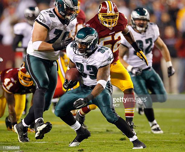 Philadelphia Eagles running back Jerome Harrison carries during a 50yard touchdown run in the first quarter against the Washington Redskins at FedEx...