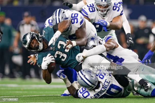 Philadelphia Eagles Running Back Josh Adams is gang tackled by Dallas Cowboys Defensive End Demarcus Lawrence Defensive Tackle Maliek Collins and...