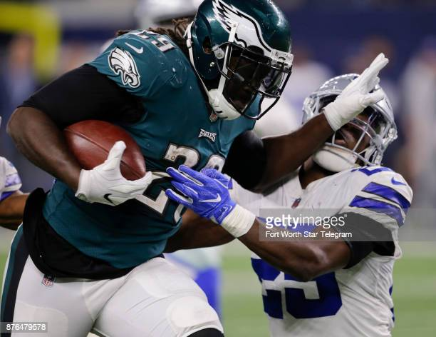 Philadelphia Eagles running back LeGarrette Blount runs through a tackle by Dallas Cowboys safety Xavier Woods in the fourth quarter on Sunday, Nov....
