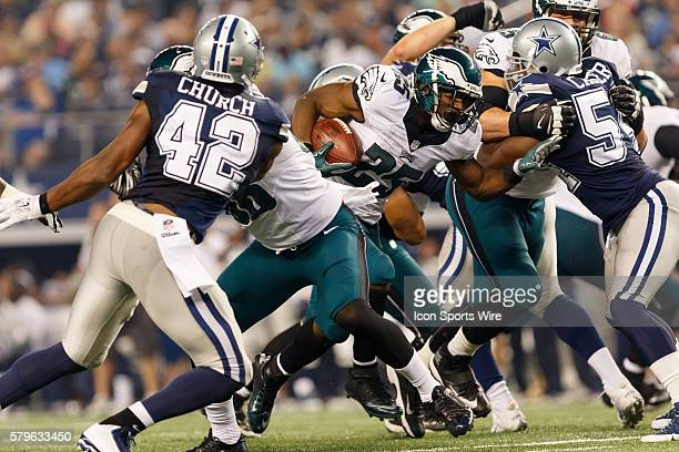 Philadelphia Eagles Running Back LeSean McCoy [11359] fights his way through the Cowboys defensive line during the NFL football game between the...