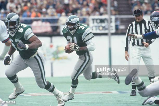 Philadelphia Eagles' running back Wilbert Montgomery gains yardage as he runs the ball against the New York Giants during a game at Veterans Stadium...