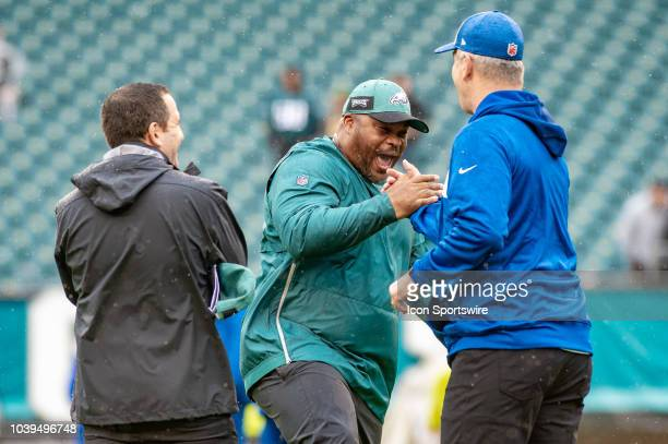 Philadelphia Eagles running backs coach Duce Stalet greets Indianapolis Colts head coach Frank Reich during pregame of the National Football League...
