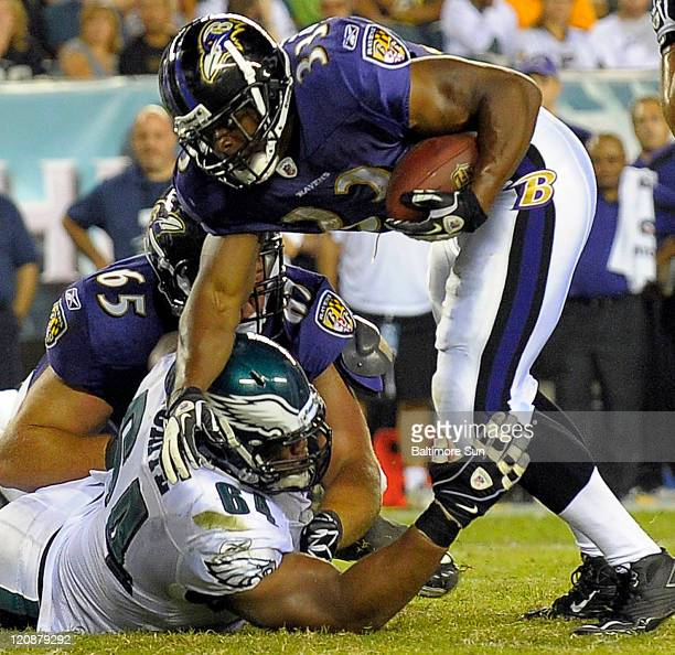 Philadelphia Eagles' Ryan Harris stops Baltimore Ravens running back Jalen Parmele in the third quarter of the NFL preseason opener at Lincoln...