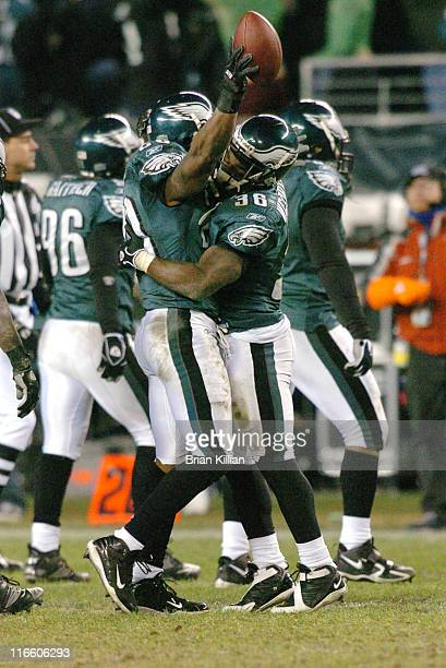 Philadelphia Eagles safety Brian Dawkins is congratulated by teammate Brian Westbrook after making an interception that changed the course of the...