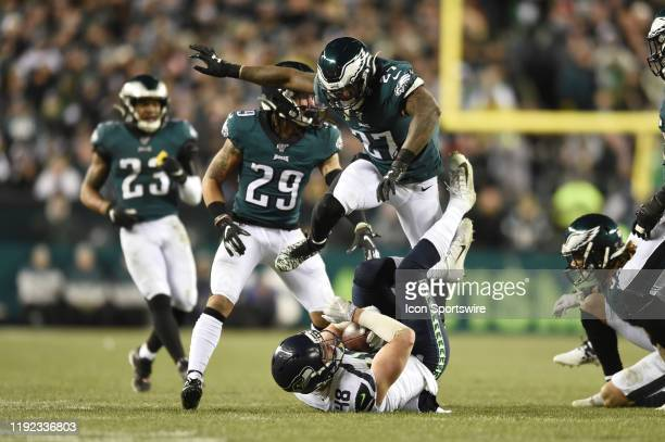 Philadelphia Eagles strong safety Malcolm Jenkins leaps over Seattle Seahawks tight end Jacob Hollister during the Playoff game between the Seattle...