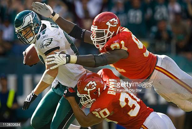 Philadelphia Eagles tight end Brent Celek scores a touchdown against Kansas City Chiefs linebacker Tamba Hali top right and safety Mike Brown lower...