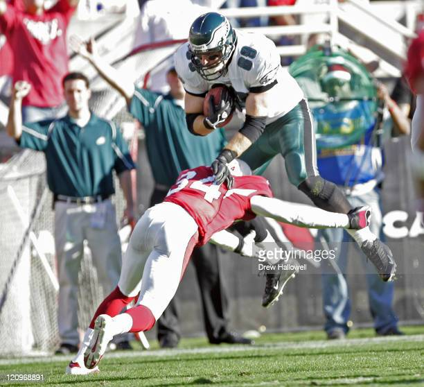 Philadelphia Eagles tight end Chad Lewis hurdles over Arizona Cardinals safety Robert Griffith on a fourth down trick play Thursday December 22 2005...