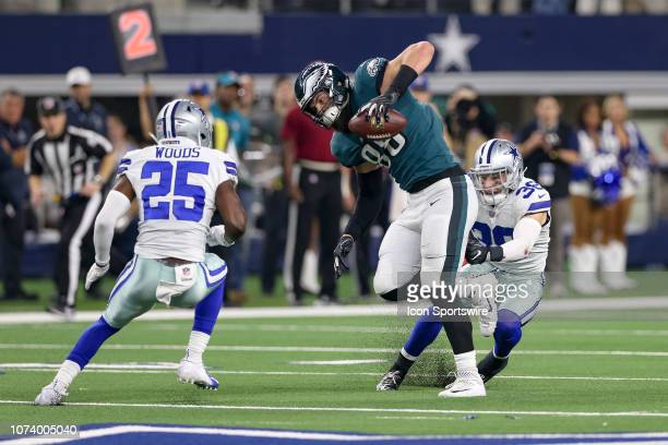Philadelphia Eagles Tight End Dallas Goedert makes a reception between Dallas Cowboys Safety's Jeff Heath and Xavier Woods during the game between...
