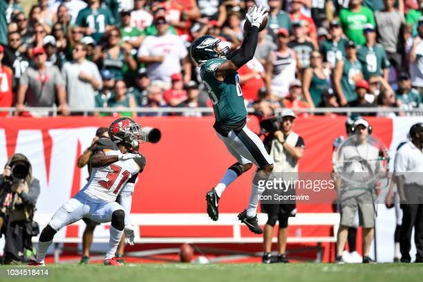 Philadelphia Eagles tight end Joshua Perkins jumps up to make a catch in front of Tampa Bay Buccaneers safety Jordan Whitehead during the second half...