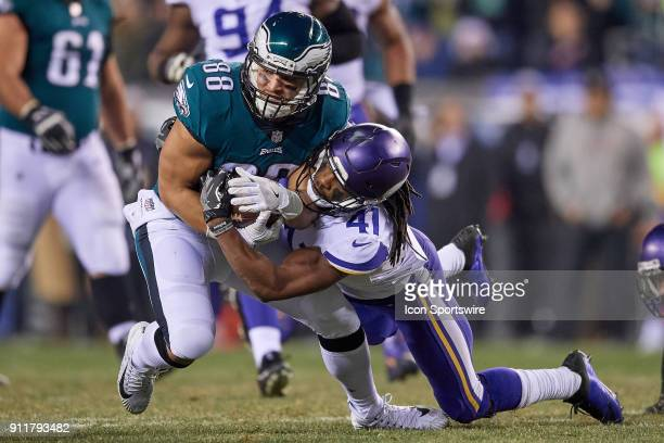 Philadelphia Eagles tight end Trey Burton battles with Minnesota Vikings strong safety Anthony Harris during the NFC Championship Game between the...